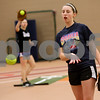 Monica Maschak - mmaschak@shawmedia.com<br /> DeKalb's senior Katie Kowalski warms up her arm during softball practice on Wednesday, March 19, 2014.