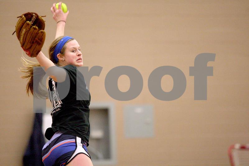 Monica Maschak - mmaschak@shawmedia.com<br /> DeKalb sophomore Morgan Newport winds up on a pitch during softball practice on Wednesday, March 19, 2014.