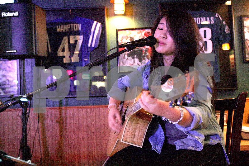 Monica Maschak - mmaschak@shawmedia.com<br /> Annabell Castillo, 16, of Sycamore performs during Open Mic Night at Fatty's in DeKalb on Monday, March 24, 2014.