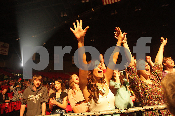 Danielle Guerra - dguerra@shawmedia   Northern Illinois University students Lauren Burron (center) and Sarah Moudy (right) scream during the Chase Rice concert Thursday night.
