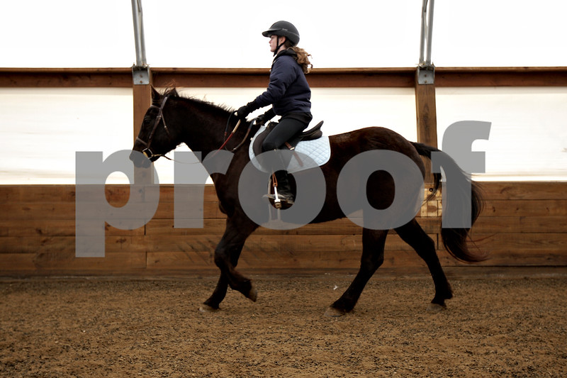 Monica Maschak - mmaschak@shawmedia.com<br /> Maria Carpino, 12, rides her horse, Beau, during an Advanced Spring Break Horse Camp at Runaway Ranch in Sycamore on Tuesday, March 25, 2014.