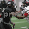 Danielle Guerra - dguerra@shawmedia.com   Northern Illinois University defensive back Marlon Moore sheds a block during practice Tuesday morning at the Chessick Center.