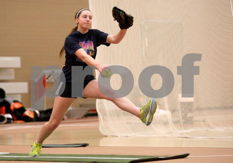Monica Maschak - mmaschak@shawmedia.com<br /> DeKalb's senior Katie Kowalski winds up on a pitch during softball practice on Wednesday, March 19, 2014.