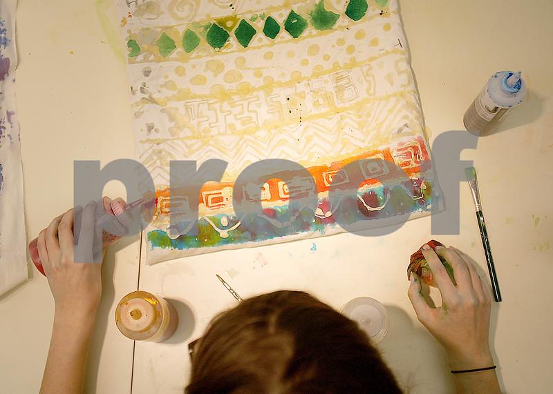 Danielle Guerra - dguerra@shawmedia   Using red dye on her batik, senior Stephanie Holbrook works  during teacher Chad Gregory's AP 2D design class at DeKalb High School on Tuesday.  DeKalb High School offers four different AP art concentrations.