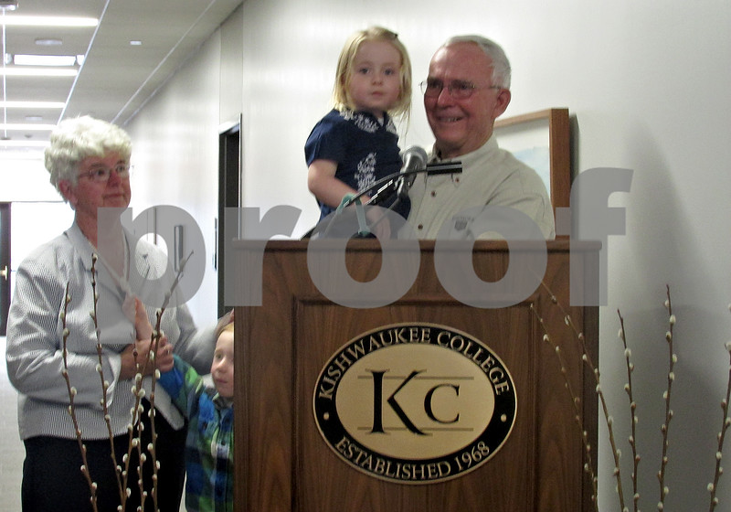 Andrea Azzo - aazzo@shawmedia.com<br /> Terry Martin holds his 3-year-old granddaughter Wren Martin as he is standing at a podium. Next to Terry is his wife, Sherrie Martin, and Wren's twin brother Archie Martin.