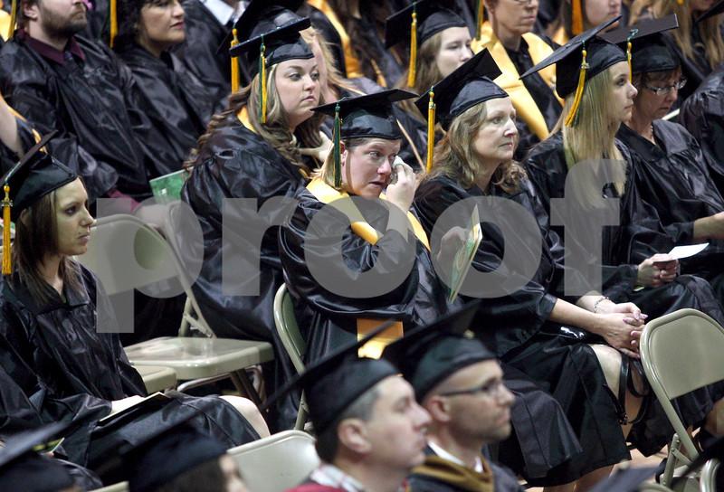 Monica Maschak - mmaschak@shawmedia.com<br /> Marcelle Schwartz wipes her eye during the Kishwaukee College graduation ceremony on Saturday, May 17, 2014.