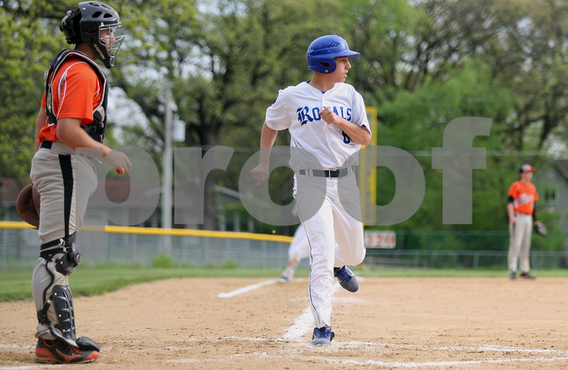 Monica Maschak - mmaschak@shawmedia.com<br /> Hinckley-Big Rock's Noah McQueen scores a run in the second inning of the class 1A regional quarterfinal game against Elgin Academy on Monday, May 19, 2014. The Royals won, 17-7 in six innings.