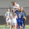 Monica Maschak - mmaschak@shawmedia.com<br /> Indian Creek's Jacklyn Bouma heads the ball in the second half of the class 3A regional game on Saturday, May 17, 2014. The Cogs lost to the T'Wolves, 1-0.