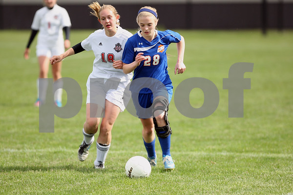 Monica Maschak - mmaschak@shawmedia.com<br /> Indian Creek's Madison Russell and Genoa-Kingston's Ashley Grimm race for the ball in the first half of the class 3A regional game on Saturday, May 17, 2014. The Cogs lost to the T'Wolves, 1-0.
