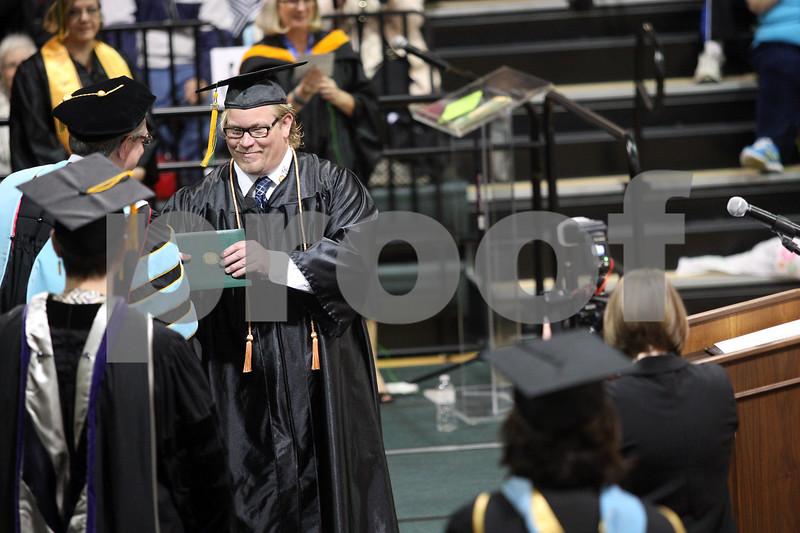 Monica Maschak - mmaschak@shawmedia.com<br /> Freddrick Hornbuckle Jr. accepts his diploma for nursing at the Kishwaukee College graduation ceremony on Saturday, May 17, 2014.