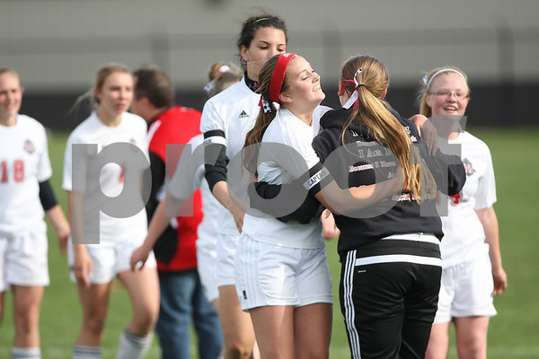 Monica Maschak - mmaschak@shawmedia.com<br /> Indian Creek's Bailey Martenson hugs her teammate after winning the class 3A regional game against Genoa-Kingston on Saturday, May 17, 2014. The Cogs lost to the T'Wolves, 1-0.