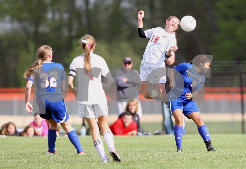 Monica Maschak - mmaschak@shawmedia.com<br /> Indian Creek's Madison Russell heads the bal in the second half of the class 3A regional game on Saturday, May 17, 2014. The Cogs lost to the T'Wolves, 1-0.