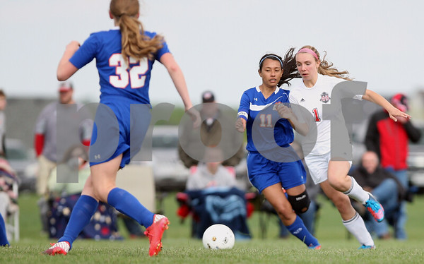 Monica Maschak - mmaschak@shawmedia.com<br /> Genoa-Kingston's Perla Orozco collides with Indian Creek's Renee Corriveau for the ball in the second half of the class 3A regional game on Saturday, May 17, 2014. The Cogs lost to the T'Wolves, 1-0.