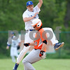 Monica Maschak - mmaschak@shawmedia.com<br /> Hinckley-Big Rock's Noah McQueen catches the ball in midair in an attempt to tag out a runner in the second inning of the class 1A regional quarterfinal game against Elgin Academy on Monday, May 19, 2014. The Royals won, 17-7 in six innings.