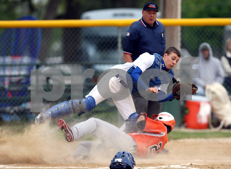 Monica Maschak - mmaschak@shawmedia.com<br /> Hinckley-Big Rock's Bailey McQueen tags out a runner in the third inning of the class 1A regional quarterfinal game against Elgin Academy on Monday, May 19, 2014. The Royals won, 17-7 in six innings.