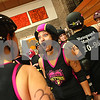 "Danielle Guerra - dguerra@shawmedia.com<br /> Barbed Wire Betties' Natasha Earl, ""Wine-O-Holic,""celebrates with the team after beating the DuPage Derby Dames in the Betties' first home bout at Huntley Middle School in DeKalb on Saturday, November 8, 2014.  The Betties beat the Dames, 161-133."