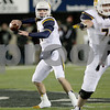 Monica Synett - msynett@shawmedia.com<br /> Toledo quarterback Logan Woodside, filling in for Michael Julian, looks to pass in the second quarter against Northern Illinois on Tuesday, November 11, 2014. The Huskies are up 13-10 at half.