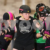 "Danielle Guerra - dguerra@shawmedia.com<br /> Lee Clark, ""Menopausal Mayhem,"" helps block out the DuPage Derby Dames during the Barbed Wire Betties' first home bout at Huntley Middle School in DeKalb on Saturday, November 8, 2014.  The Betties beat the Dames, 161-133."