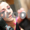 "Danielle Guerra - dguerra@shawmedia.com<br /> Sarah Snow, ""Snowbeast,"" of Rochelle, puts on her mascara with her wrist guards on before the Barbed Wire Betties first home bout at Huntley Middle School against the DuPage Derby Dames on Saturday, November 8, 2014.  The Betties beat the Dames, 161-133."