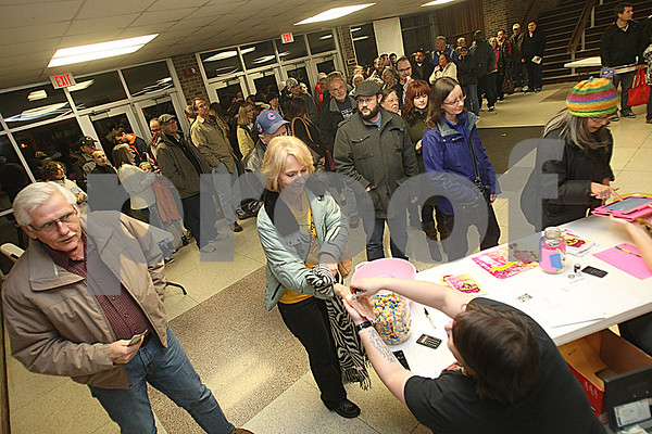Danielle Guerra - dguerra@shawmedia.com<br /> The line formed through the front door of Huntley Middle School to watch the Barbed Wire Betties skate against the DuPage Derby Dames for the Betties' first home bout at Huntley Middle School in DeKalb on Saturday, November 8, 2014.  The Betties beat the Dames, 161-133.