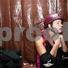 "Danielle Guerra - dguerra@shawmedia.com<br /> Amber Kantorowicz, ""Crack Her Jax,"" puts on her helmet in the dressing room before the Barbed Wire Betties first home bout at Huntley Middle School against the DuPage Derby Dames on Saturday, November 8, 2014.  The Betties beat the Dames, 161-133."