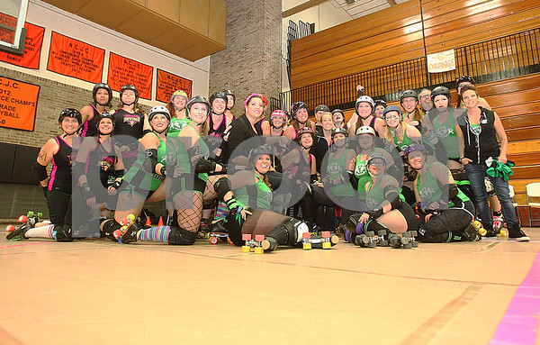Danielle Guerra - dguerra@shawmedia.com<br /> The Barbed Wire Betties pose with the DuPage Derby Dames after the Betties' first home bout at Huntley Middle School in DeKalb on Saturday, November 8, 2014. The Betties skated on their new portable track for the first time after a number of fundraisers to raise money to buy the floor. The Betties beat the Dames, 161-133.