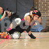 "Danielle Guerra - dguerra@shawmedia.com<br /> Amy Gahala, ""TsunAmy,"" takes an early fall while lead jammer during the Barbed Wire Betties' first home bout at Huntley Middle School in DeKalb against the DuPage Derby Dames on Saturday, November 8, 2014.  The Betties beat the Dames, 161-133."