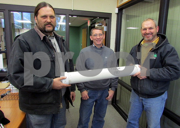 Katie Dahlstrom - kdahlstrom@shawmedia.com<br /> DeKalb Park District capital project crew members Tom Boyce and Roger Olsen and projects manager Todd Bex hold the time capsule they found while demolishing the Adventures in Barbland playground.