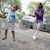 "Monica Synett - mmaschak@shawmedia.com<br /> Keyana Williams, 26, turns the jump rope for her 3-year-old son, Jeramie Green, outside of their apartment at University Village. Other children in the neighborhood like to gather and jump rope or hula hoop when Williams is outside playing with her children. ""It was something for me to start over again,"" Williams said about University Village."
