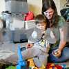"Monica Synett - mmaschak@shawmedia.com<br /> Eve Besser, 35, plays with her 5-year-old son, Ziggy, in the living room of their two-bedroom apartment at University Village. Besser and her three children have bounced from place to place looking for a place to call their home, when she got the call saying she was approved for an apartment at University Village one year ago. ""It was like, this is mine,"" Besser said."