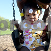 "Monica Synett - mmaschak@shawmedia.com<br /> London Ellison, 1, gets pushed on the swing by her father, Raymond Ellison, at the Welsh Park playground adjacent to University Village. Ellison recently moved to University Village from Maywood to be with his girlfriend and his two daughters. ""I wouldn't let my kids play outside like this in Maywood,"" Ellison said. ""There's too much stuff going on."""