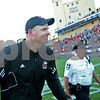 Danielle Guerra - dguerra@shawmedia.com<br /> Northern Illinois University head coach Rod Carey runs off Ryan Field after the Huskies' win over Northwestern, 23-15, on Saturday, Sept. 6, 2014.