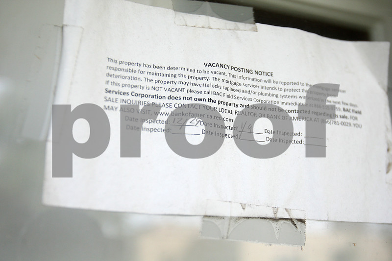 Monica Maschak - mmaschak@shawmedia.com<br /> A vacancy posting notice is taped to the front door of the house at 628 Culver St., DeKalb. The house, across the street from Founders Elementary School, sits vacant due to a foreclosure.