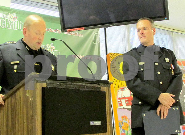 Katie Dahlstrom - kdahstrom@shawmedia.com<br /> DeKalb police officer Jeff Winters (right) received three commendations during the DeKalb City Council meeting Monday, Sept. 8.