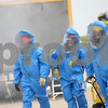DeKalb County Hazmat team members Matt Speerly, of Waterman, and Tom Conley and Colin Juraska, both of DeKalb, leave the scene to get decontaminated during a Hazmat Division 6 drill at the DeKalb Taylor Municipal Airport on Thursday, Sept. 18, 2014. Danielle Guerra - dguerra@shawmedia.com
