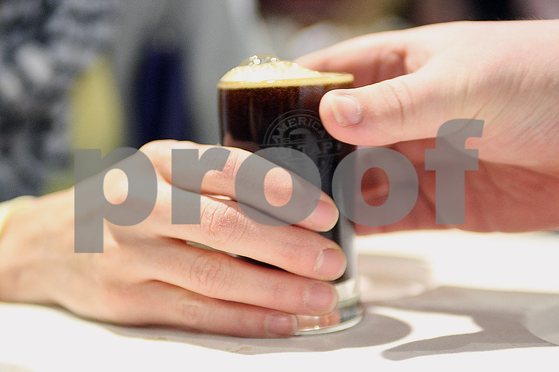 Monica Synett - msynett@shawmedia.com<br /> Cademon Brewing served samples of two of their beers — Eve's Future Favorite peanut butter porter and Vanilla Demonic — during the annual America on Tap Beer Festival at the Convocation Center in DeKalb on Saturday, March 28, 2015.