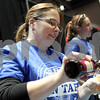 Monica Synett - msynett@shawmedia.com<br /> Christine Pellenz, a volunteer from TAILS Humane Society, serves samples of McKenzie's Hard Cider during the annual America on Tap Beer Festival at the Convocation Center in DeKalb on Saturday, March 28, 2015. This is the festival's first year in DeKalb and the event sold out to 1600 people. Seventy four national and local breweries were represented at the event.