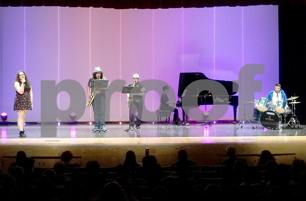 "Katrina Milton - kmilton@shawmedia.com<br /> The student music group MUSHA performs Radiohead's ""Creep"" during Sycamore's Got Talent on Friday, April 10, 2015  at Sycamore High School, 427 Spartan Trail."