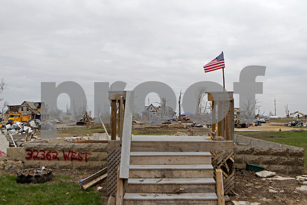 Danielle Guerra - dguerra@shawmedia.com<br /> A flag, staked on the foundation of a house in Fairdale, blows in the wind on Thursday, April 16, 2015. Terri D'Amato, Kirkland village clerk, said they are expecting many volunteers to come to the area this weekend.