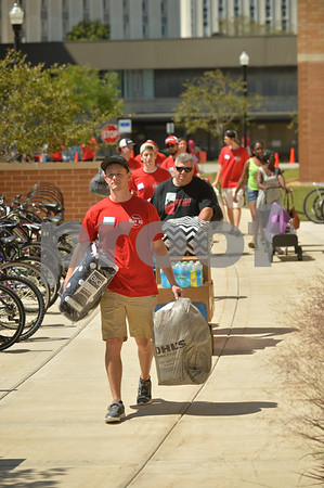 Mary Beth Nolan - mnolan@shawmedia.com<br /> Senior Max Finley, an athletic training major, leads a line of volunteers and helpers moving new students move into New Residence Hall West at Northern Ilinois University Friday August 21, 2015.