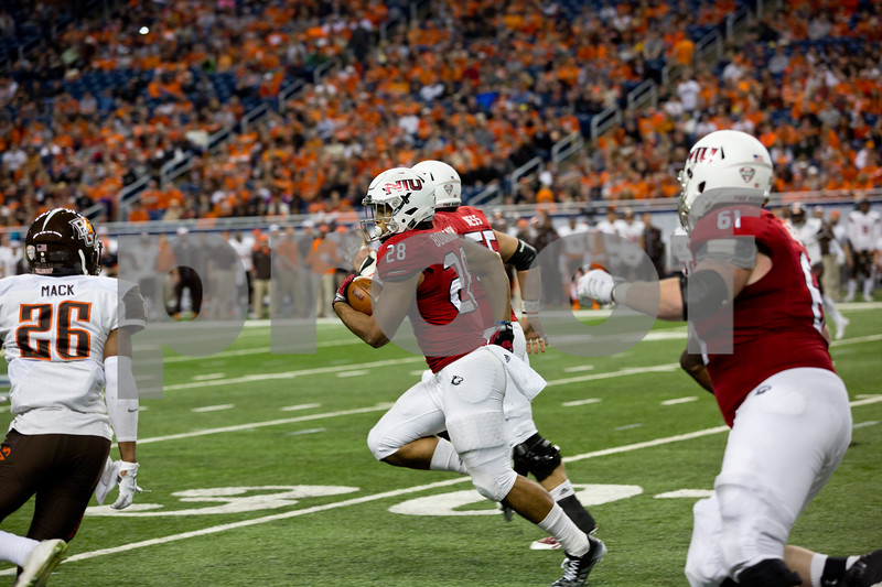 Laura McDermott for Shaw Media     <br /> Northern Illinois University junior tailback Joel Bouagnon runs the ball down the field during the 2015 MAC Championship Game against Bowling Green University at Ford Field in Detroit, Mich. on Dec. 4, 2015. Bowling Green University beat Northern Illinois University 34-14.