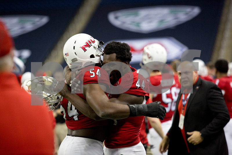 Laura McDermott for Shaw Media  <br /> Northern Illinois University players Boomer Mays, right, and Cameron Clinton-Earl, left, embrace after scoring against Bowling Green University during the 2015 MAC Championship Game at Ford Field in Detroit, Mich. on Dec. 4, 2015. Bowling Green University beat Northern Illinois University 34-14.