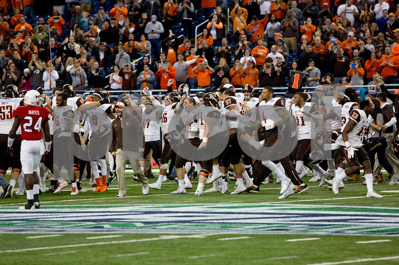 Laura McDermott for Shaw Media        <br /> Bowling Green University players celebrate after beating Northern Illinois University 34-14 in the 2015 MAC Championship Game at Ford Field in Detroit, Mich. on Dec. 4, 2015.