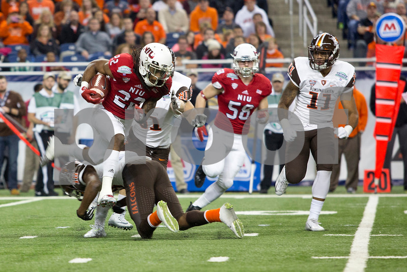 Laura McDermott for Shaw Media                  <br /> Northern Illinois University senior safety jumps past a Bowling Green University player as he runs the ball down the field during the 2015 MAC Championship Game at Ford Field in Detroit, Mich. on Dec. 4, 2015. Bowling Green University beat Northern Illinois University 34-14.