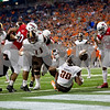 Laura McDermott for Shaw Media<br /> Bowling Green University junior running back holds onto the ball as he scores a touchdown against Northern Illinois University during the first quarter at the 2015 MAC Championship Game at Ford Field in Detroit, Mich. on Dec. 4, 2015.
