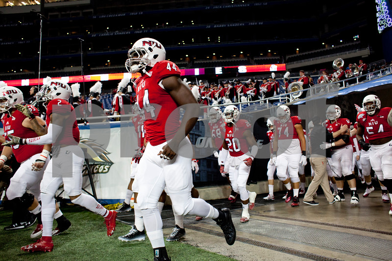 Laura McDermott for Shaw Media           <br /> Northern Illinois University players enter the field for the 2015 MAC Championship Game against Bowling Green University at Ford Field in Detroit, Mich. on Dec. 4, 2015. Bowling Green University beat Northern Illinois University 34-14.