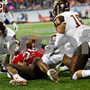 Laura McDermott for Shaw Media<br /> Northern Illinois University junior tailback Joel Bouagnon hangs on to the ball as he is taken down by Bowling Green University defense during the first quarter at the 2015 MAC Championship Game at Ford Field in Detroit, Mich. on Dec. 4, 2015.