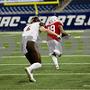 Laura McDermott for Shaw Media<br /> Northern Illinois University sophomore corner back Shawum Lurry is chased by Bowling Green University junior wide receiver Gehrig Dieter as he runs the ball for a touchdown in the third quarter during the 2015 MAC Championship Game at Ford Field in Detroit, Mich. on Dec. 4, 2015. Bowling Green University beat Northern Illinois University 34-14.