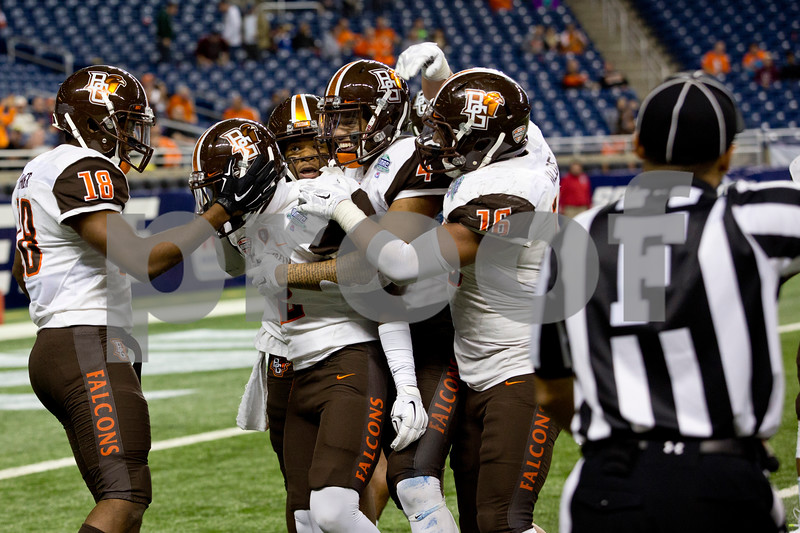 Bowling Green University players celebrate scoring agains t Northern Illinois University during the 2015 MAC Championship Game at Ford Field in Detroit, Mich. on Dec. 4, 2015. Bowling Green University beat Northern Illinois University 34-14.