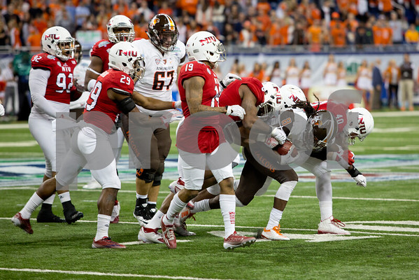 Laura McDermott for Shaw Media              <br /> Bowling Green University senior running back Travis Greene holds onto the ball as he is taken down by the Northern Illinois University defense during the 2015 MAC Championship Game at Ford Field in Detroit, Mich. on Dec. 4, 2015. Bowling Green University beat Northern Illinois University 34-14.